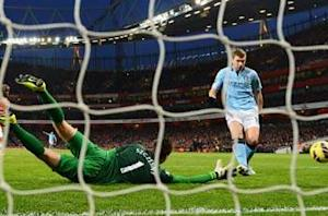 Arsenal 0-2 Manchester City: Milner and Dzeko down Gunners as both sides see red