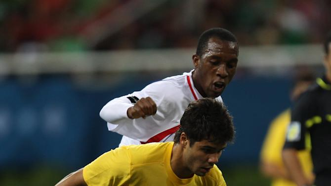 Brazil's Henrique Nascentes drives the ball fights followed by Costa Rica's Jorge Davis, rear, during a men's soccer match at the Pan American Games in Guadalajara, Mexico, Sunday, Oct. 23, 2011. (AP Photo/Juan Karita)