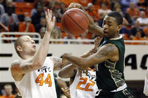 No. 23 Cowboys rebound from loss, beat USF 61-49