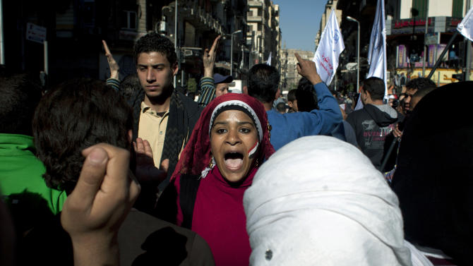 "Egyptian protesters chant slogans denouncing the proposed constitution and the upcoming referendum during a rally in Cairo, Egypt, Thursday, Dec. 13, 2012. Egyptian President Mohammed Morsi's Muslim Brotherhood and other Islamists have been plastering posters across much of the country urging Egyptians to vote ""yes"" and listing what they call the advantages of the new charter. ""Yes, to protecting (Islamic) Sharia (laws),"" says a Brotherhood website. The Islamists have also been using mosques to disseminate the ""yes"" message and putting to use their appeal to uneducated Egyptians in rural areas. But the pros and cons of the draft constitution and the question of whether it will be passed have grown more akin to being a secondary narrative to the worst crisis to hit Egypt since the overthrow nearly two years ago of Hosni Mubarak's authoritarian regime.(AP Photo/Nasser Nasser)"