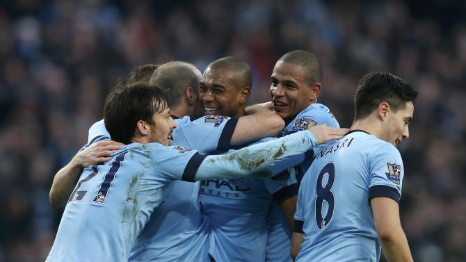 Manchester City's Fernandinho celebrates with team-mates after scoring a goal against Burnley during their English Premier League soccer match at the Etihad Stadium in Manchester