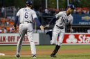 Tampa Bay Rays' B.J. Upton, right, high-fives third base coach Tom Foley as he rounds the bases after hitting a solo home run in the first inning of a baseball game against the Baltimore Orioles in Baltimore, Wednesday, Sept. 12, 2012. (AP Photo/Patrick Semansky)