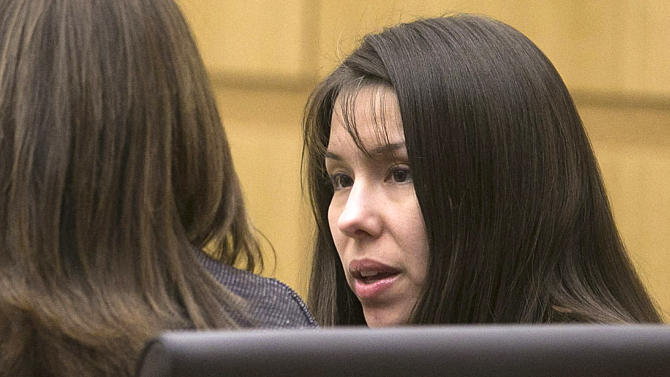 FILE - In this Jan. 2,2013 file photo, defendant, Jodi Arias, listens during the prosecution's opening statements in Maricopa County court in Phoenix. Arias is charged in the murder of her boyfriend, Travis Alexander. The jury expected to decide whether Arias should be convicted of murder. Arias claims it was self defense, but prosecutors claim she flew into a jealous rage after Alexander tried to break off the relationship.  (AP Photo/The Arizona Republic, David Wallace,File)  MARICOPA COUNTY OUT; MAGS OUT; NO SALES