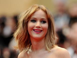 Cannes 2013 : Jennifer Lawrence lumineuse pour Liam Hemsworth, sans Miley Cyrus