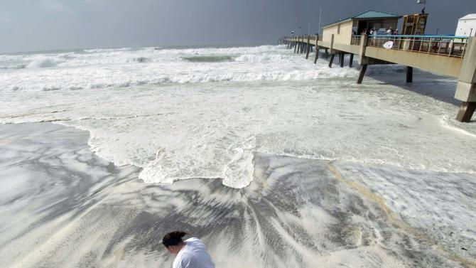 L'Rena Anderson leans into the wind as she walks along the beach on Okaloosa Island in Fort Walton Beach, Fla., Tuesday, Aug. 28, 2012. Anderson was among many local residents who turned out to watch the effects of Hurricane Isaac as it churns through the Gulf of Mexico toward an expected landfall in Louisiana. (AP Photo/Northwest Florida Daily News, Devon Ravine)