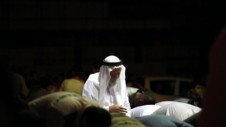 FILE - Hamza Mansour, secretary general of the Islamic Action Front, joins Syrians living in Amman, Jordan, for their Ramadan prayers in front of the Syrian embassy, as they call for Syrian President Bashar Assad to step down, Friday, Aug. 26, 2011. (AP Photo/Mohammad Hannon, File)