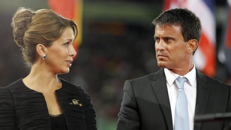 Jordan's Princess Haya bint Hussein, President of the International Equestrian Federation speaks with French Prime Minister Manuel Valls during the opening ceremony of the world Equestrian Games in Caen