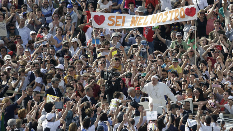 Pope Francis arrives to meets with faithful of the ecclesiastic movements on the occasion of a Pentecost vigil in St. Peter's Square at the Vatican, Saturday, May 18, 2013. (AP Photo/Gregorio Borgia)