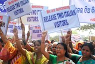 Indian women demand the release of hostages Paolo Bosusco and Claudio Colangelo, at a rally in Bhubaneswar on March 22. Negotiations to free the two Italians, who were kidnapped by Indian Maoists rebels, were plunged into uncertainty fter the rebels kidnapped a local lawmaker