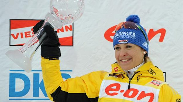 Germany's Magdalena Neuner celebrates with her all-season trophy on the podium after the women's 12.5 km mass start event of the Biathlon Word Cup in the Siberian city of Khanty-Mansiysk, on March 18, 2012