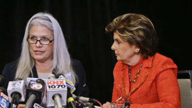 Attorney Gloria Allred, right, listens as her client, Irene McCormack, talks about the alleged sexual misconduct she suffered at the hands of San Diego Mayor Bib Filner at a news conference in San Diego, Monday, July 22, 2013. McCormack had been Communications Director for Mayor Filner. (AP Photo/Lenny Ignelzi)