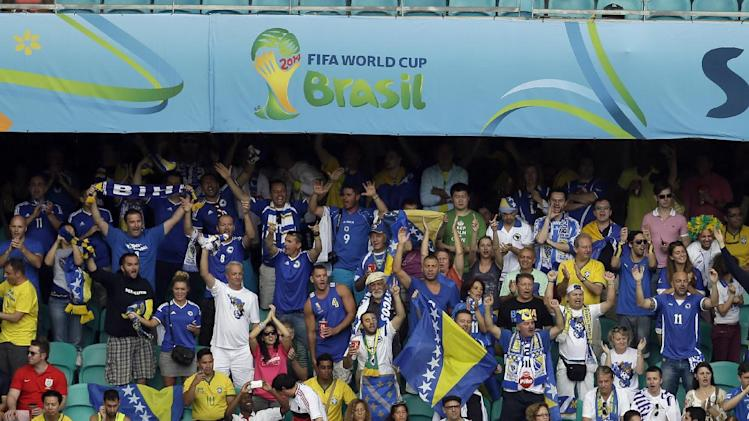 Bosnia fans cheer during the second half of a group F World Cup soccer match against Iran at the Arena Fonte Nova in Salvador, Brazil, Wednesday, June 25, 2014. (AP Photo/Themba Hadebe)
