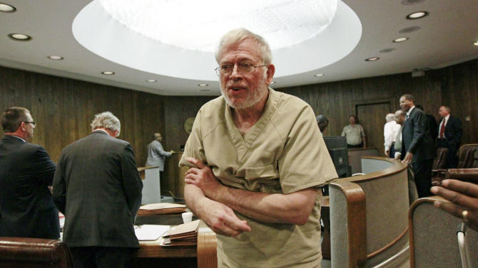 Dr. Ralph Arnold Smith Jr., 70, looks around for his family at the Leflore County Court in Greenwood, Miss., following his preliminary hearing Wednesday, May 16, 2012, where it was determined there was enough probable cause for him to be turned over to a grand jury.Smith Jr. will remain in jail without bond, the judge ruled Wednesday. Smith  is charged with conspiring to kill attorney Lee Abraham, who represented Smith's ex-wife during the couple's divorce in the 1990s. (AP Photo/Rogelio V. Solis)
