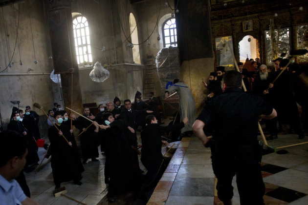 Armenian and Greek Orthodox clergymen scuffle inside the Church of Nativity, believed by many to be the birthplace of Jesus Christ, in the West Bank town of Bethlehem, Wednesday, Dec. 28, 2011. The tw