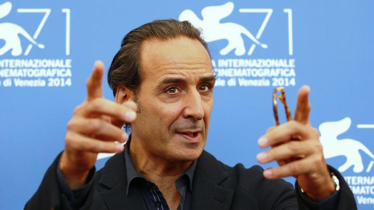 French film composer Alexandre Desplat, president of the jury at the 71st Venice Film Festival, poses during a photo call for the event in Venice