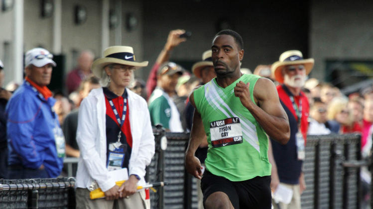 Tyson Gay sprints past spectators during his preliminary heat of the 100-meter race during the U.S. track and field championships in Eugene, Ore., Thursday, June, 23, 2011.  Gay qualified for the semifinals. (AP Photo/Don Ryan)