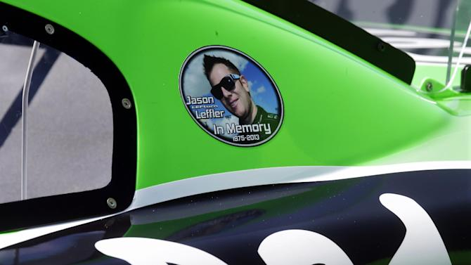 A Jason Leffler sticker is seen on Danica Patrick's car before qualifying, Friday, June 14, 2013 for Sunday's Quicken Loans 400 auto race at Michigan International Speedway in Brooklyn, Mich. The death of NASCAR driver Leffler at a dirt-track race near Philadelphia earlier this week has brought more attention to small, local tracks, where some big names like Tony Stewart still show up to race on occasion. (AP Photo/Carlos Osorio)