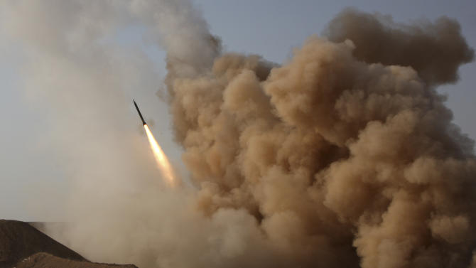 In this photo released by the semi-official Iranian Fars News Agency, and taken on Tuesday, June 28, 2011, a Zelzal missile is launched by the Iranian revolutionary Guards during their maneuvers outside the city of Qom, Iran. (AP Photo/Fars News Agency, Mohammad Hasanzadeh)