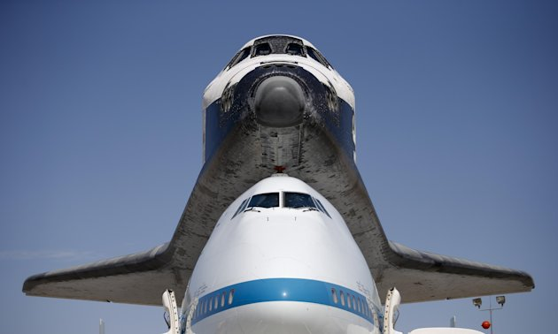 The Space Shuttle Endeavour sits atop NASA&#39;s Shuttle Carrier Aircraft (SCA) at the NASA Dryden Flight Research Center at Edwards Air Force Base, Calif., Thursday, Sept. 20, 2012. Endeavour returned to its California roots after a wistful cross-country journey that paid homage to NASA workers and former Arizona Rep. Gabrielle Giffords and her astronaut husband. (AP Photo/Jae C. Hong)