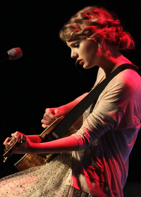 Taylor Swift performs during the Nashville Songwriters Hall of Fame Inductions on Sunday, Oct. 16, 2011, in Nashville, Tenn. (AP Photo/Mark Humphrey)