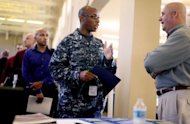 Navy Sailor E-5 Cedric Washington (L) speaks with Sim Garriotti from Lockheed Martin while interviewing for a potential position at the Opportunity Job Fair on September 6 in San Diego, California. A glum US jobs market report for August on Friday was bad news for President Obama&#39;s reelection fight but raised the likelihood that the Federal Reserve will take fresh action to boost the economy