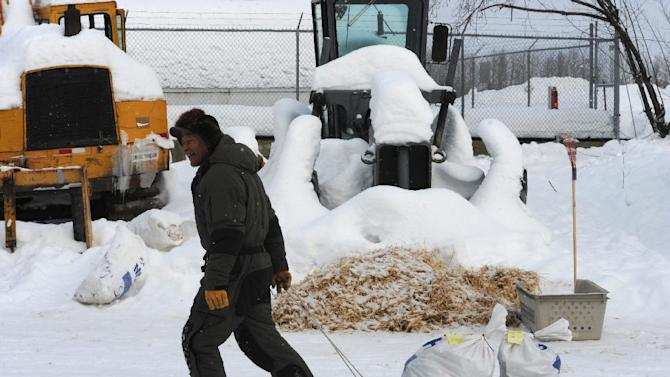 Rudy Demoski hauls his drop bags in the McGrath checkpoint during the Iditarod Trail Sled Dog Race on Wednesday, March 6, 2013. (AP Photo/The Anchorage Daily News, Bill Roth)  LOCAL TV OUT (KTUU-TV, KTVA-TV) LOCAL PRINT OUT (THE ANCHORAGE PRESS, THE ALASKA DISPATCH)