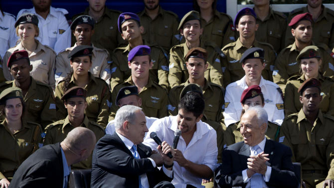 Israeli Prime Minister Benjamin Netanyahu, second left, sings in honor of soldiers, during Israel's Independence Day celebration at the President's residence in Jerusalem, Israel, Tuesday, April 16, 2013. Israel is celebrating 65 years of independence with barbeques, air force flyovers, and a bible quiz. Israeli President Shimon Peres sits at right. (AP Photo/Llia Yefimovich, Pool)