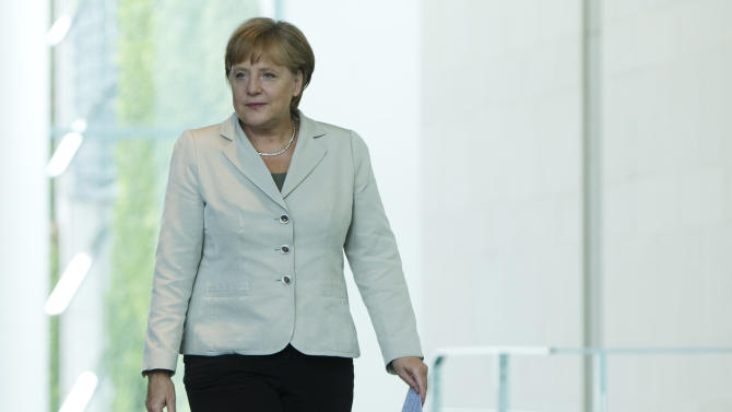 German Chancellor Angela Merkel arrives for a news conference with Jean Ping Chairperson of the Commission of the African Union, not pictured,  after talks at the chancellery in Berlin, Germany, Tuesday, July 5, 2011. Angela Merkel rebuffs the rating agencies central role in judging the new bailout plan for Greece that will see private creditors see share part of the burden. Merkel said Tuesday it was important that the institutions helping Greece, the International Monetary Fund, the European Central bank and the European Council, will make their own assesment regarding Greece's credit rating. (AP Photo/Markus Schreiber)