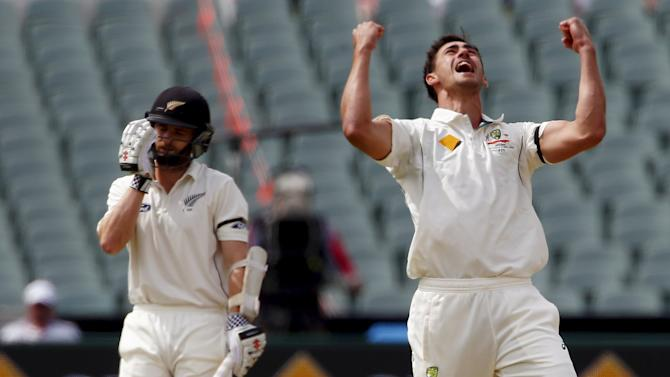 Australia's Mitchell Starc (R) celebrates dismissing New Zealand's Kane Williamson LBW for 22 runs during the first day of the third cricket test match at the Adelaide Oval, in South Australia