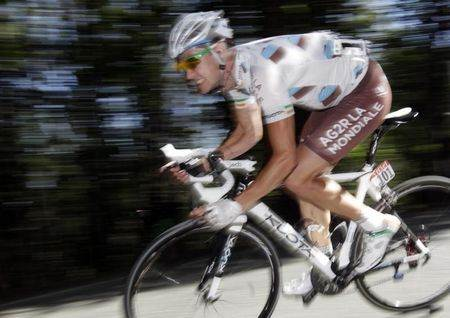 Ag2r La Mondiale rider Roche of Ireland speeds down during the 17th stage of the Tour de France 2011 cycling race
