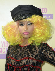 FILE - In this Thurs., Sept. 6, 2012 file photo, Nicki Minaj arrives at the MTV Video Music Awards in Los Angeles. The flamboyant rapper confirmed Monday, Sept. 10, 2012 that she did not endorse Republican nominee Mitt Romney when she rapped about him. Her comment was made Monday on Twitter in response to a radio interview given by President Barack Obama. (Photo by Jordan Strauss/Invision/AP, File)