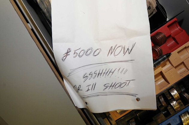 Chilling: The scrawled note left by the robber who got away with £2,000 (SWNS)