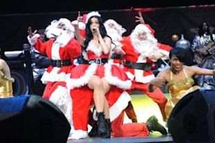 Katy Perry in what's now considered a standard Santa costume for women. (Photo by Larry Marano/Getty Images)
