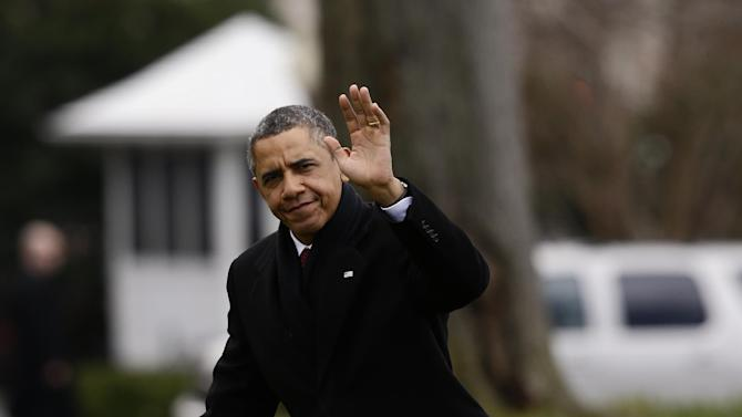 President Barack Obama waves as he steps off the Marine One helicopter and walks on the South Lawn at the White House in Washington, Thursday, Dec. 27, 2012, as he returned early from his Hawaii vacation for meetings on the fiscal cliff. (AP Photo/Charles Dharapak)