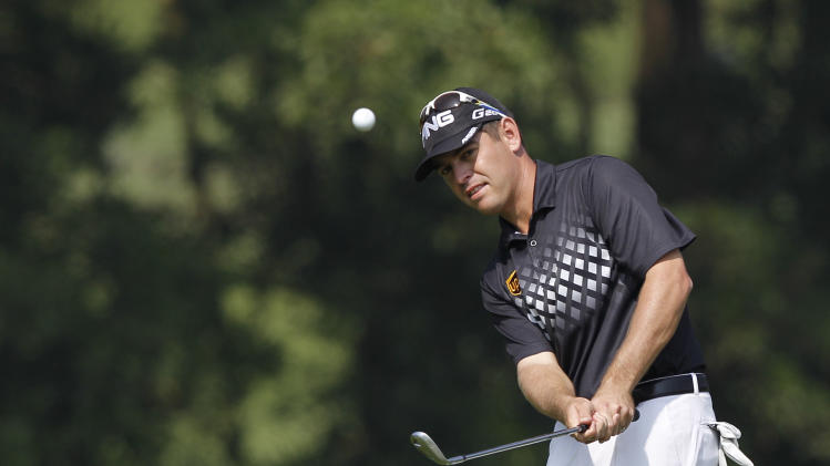 Louis Oosthuizen from South Africa hits the ball at the 9th hole during the third round of the HSBC Champions golf tournament in Dongguan, southern China's Guangdong province, Saturday Nov. 3, 2012. (AP Photo/Kin Cheung)