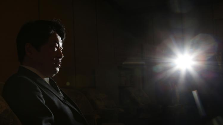 Japan's Defence Minister Onodera speaks during an interview with Reuters in Tokyo