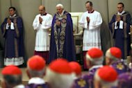 Pope Benedict XVI (C) leads the mass on February 13, 2013 at St Peter's Basilica at the Vatican