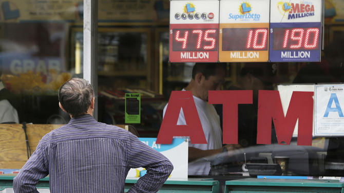 A man looks at the electronic ad for Powerball Jackpot of $475 million at the Bluebird Liquor store in Hawthorne, Calif. Thursday, May 16, 2013. The multistate lottery's website said the Powerball drawing jackpot has soared to of at least $550 million for next drawing to be held Saturday.  (AP Photo/Damian Dovarganes)