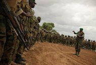 A picture taken on June 5 by the African Union-UN Information Support Team shows Ugandan soldiers serving with the AU operation based in Afgoye, some 30km to the west of the Somali capital Mogadishu. A suicide bombing Saturday at the military base housing African Union and Somali troops killed two Somali soldiers, a security official told AFP