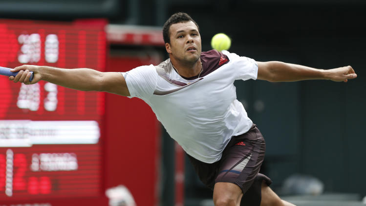 Jo-Wilfried Tsonga of France returns the ball against his compatriot Gael Monfils during their first round match at the Japan Open Tennis Championships in Tokyo, Monday, Sept. 30, 2013. (AP Photo/Koji Sasahara)