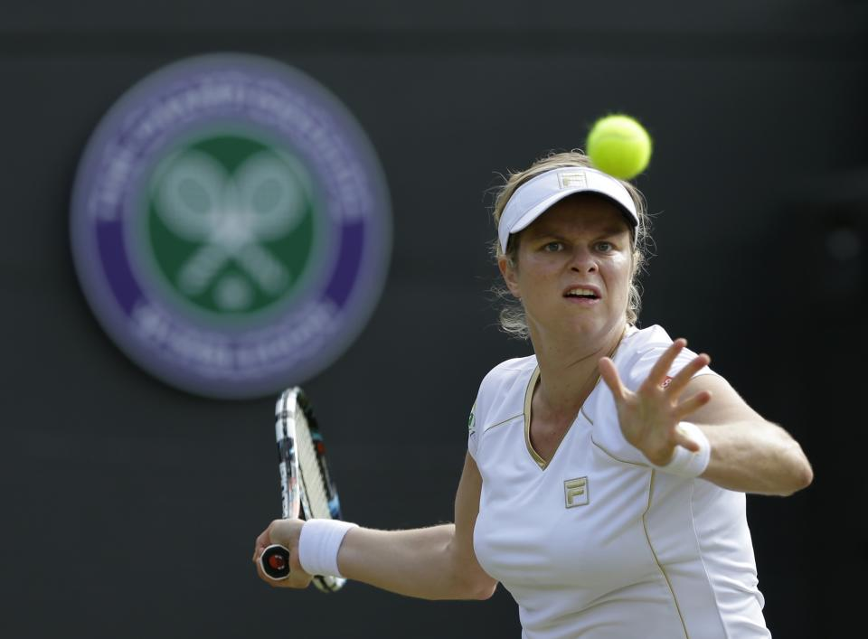 Kim Clijsters of Belgium plays a return to Vera Zvonareva of Russia during a third round women's singles match at the All England Lawn Tennis Championships at Wimbledon, England, Friday, June 29, 2012. (AP Photo/Anja Niedringhaus)