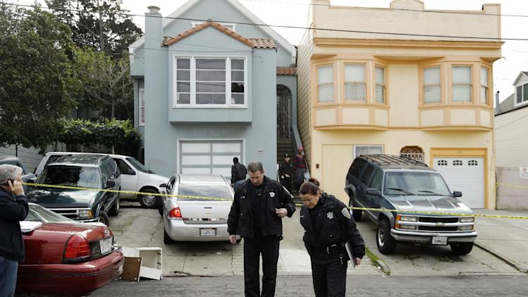 "San Francisco police officers search for evidence and guard the home of a woman who was set on fire Sunday, Jan. 6, 2013, in San Francisco. San Francisco police say a woman is hospitalized with what are being described as ""life-threatening injuries"" after someone poured a flammable liquid on her and set her on fire. Police spokesman Officer Carlos Manfredi says officers were called to the city's Bayview District a little after noon by people who reported a woman screaming. When officers arrived they found a women suffering from what Manfredi described as ""severe burns."" The woman, believed to be in her 20s, was taken to a hospital where she is being treated at a burn center. Her name has not been released. Police did not immediately release any suspect information. (AP Photo/Ben Margot)"