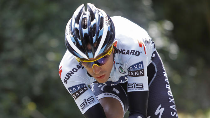 File - In this June 30, 2011 file photo, Alberto Contador of Spain trains near Les Herbiers, western France. Sport's highest court on Monday Feb. 6, 2012 has banned Contador for two years after finding the Spanish cyclist guilty of doping, a decision that will strip the 2010 Tour de France champion of his title.The Court of Arbitration for Sport has suspended Contador after rejecting his claim that his positive test for clenbuterol was caused by eating contaminated meat.Contador has continued racing since giving a positive control on a 2010 Tour rest day, and is expected to be stripped of all of his results over the past 17 months including winning the Giro d'Italia last season. (AP Photo/Laurent Cipriani, File)