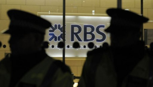 &lt;p&gt;Police officers guard the entrance of the Royal Bank of Scotland offices as protesters demonstrate against bonuses in London in January 2011. Four traders from the bank were sacked at the end of 2011 for their role in fixing inter-bank interest rates, sources have said.&lt;/p&gt;