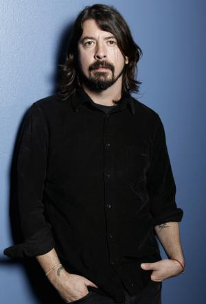 """In this Jan. 31, 2012 photo, musician Dave Grohl poses for a portrait in Los Angeles. The 43-year-old Foo Fighters frontman's band had a top-selling tour, sold more than 663,000 copies of their album """"Wasting Light"""" and were nominated for six Grammys, including album of the year. (AP Photo/Matt Sayles)"""
