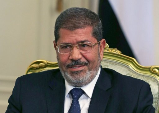 Egyptian President Mohamed Morsi, seen here on July 31, has pledged to guarantee security for tourists, whose numbers have slumped since last year's uprising in a major setback for the country's economy.