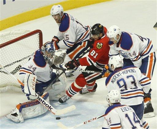 Edmonton uses 4-goal first to beat Blackhawks 6-5