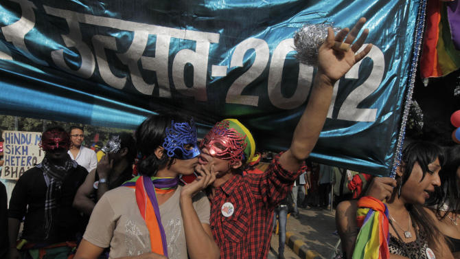 Participants gather for the 5th Delhi Queer Pride parade in New Delhi, India, Sunday, Nov. 25, 2012. Hundreds of gay rights activists marched through New Delhi on Sunday to demand that they be allowed to lead lives of dignity in India's deeply conservative society.(AP Photo/ Mustafa Quraishi)