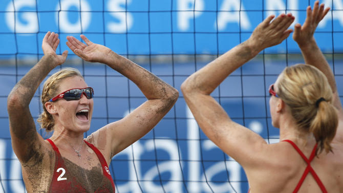 Heather Hughes, left, celebrates with teammate Emily Day after defeating Chile