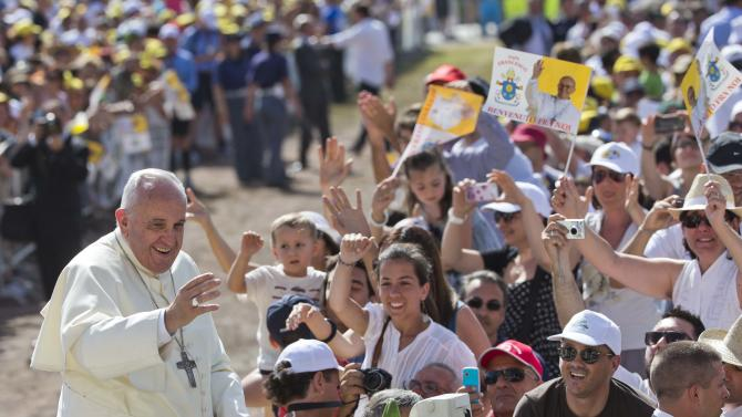 FILE - In this July 5, 2014 file photo, Pope Francis smiles as he arrives to give a mass in Campobasso, Italy, during his one day trip to the southern Italian region of Molise. The Vatican confirmed Tuesday, July 29 the dates for Pope Francis' second trip to Asia, a weeklong visit Jan. 12-19 to Sri Lanka and the Philippines. (AP Photo/Alessandra Tarantino, File)